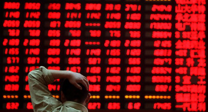 WENZHOU, CHINA - APRIL 24: (CHINA OUT) An investor views stock index at a securities company on April 24, 2008 in Wenzhou of Zhejiang Province, China. Today, the stamp tax on stock market transactions was cut to 0.1 percent from 0.3 percent to boost trading. The Shanghai Composite Index closed at 3,583.03 points, gained 9.29 percent, the biggest gain since October 23, 2001. (Photo by China Photos/Getty Images)